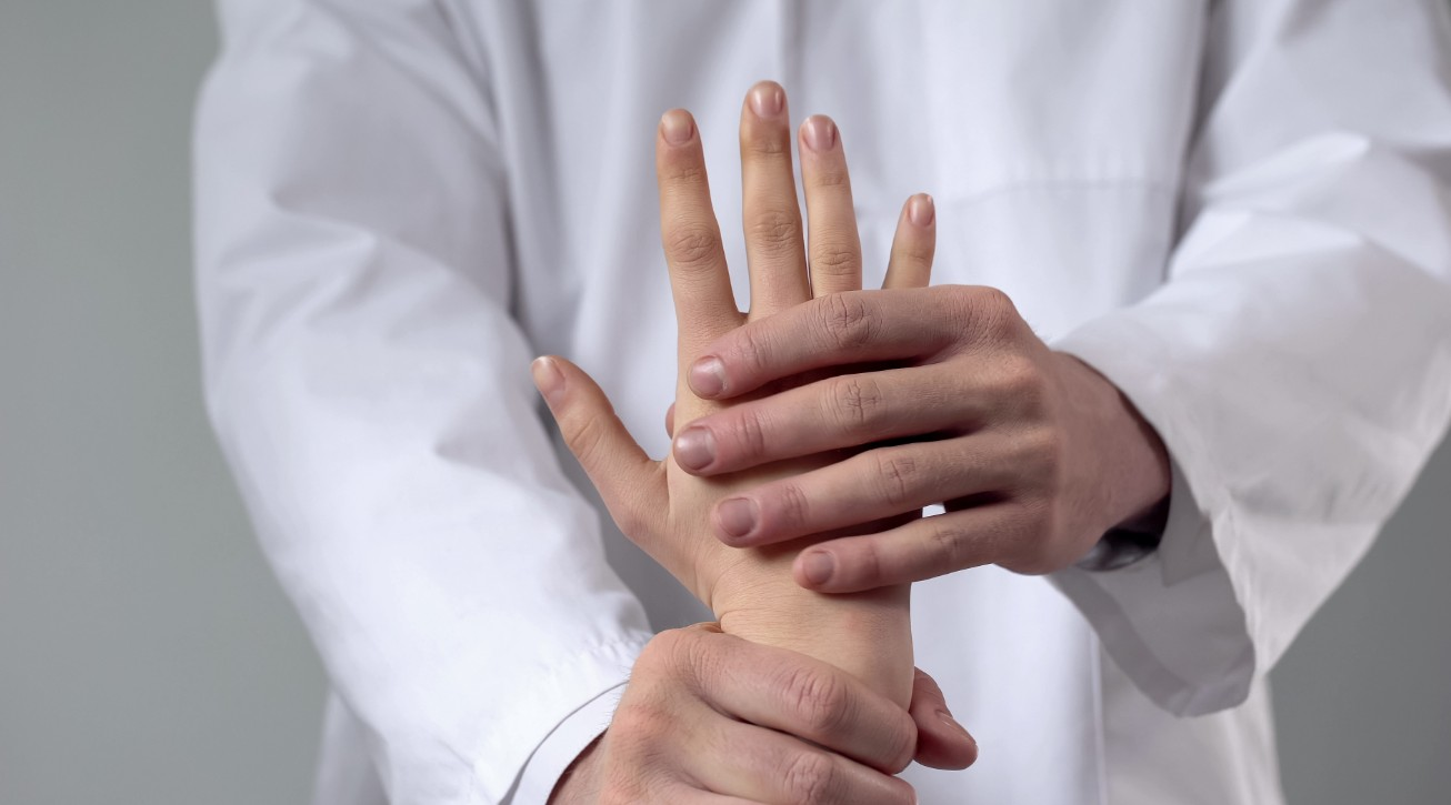 DOctor working on patient hand