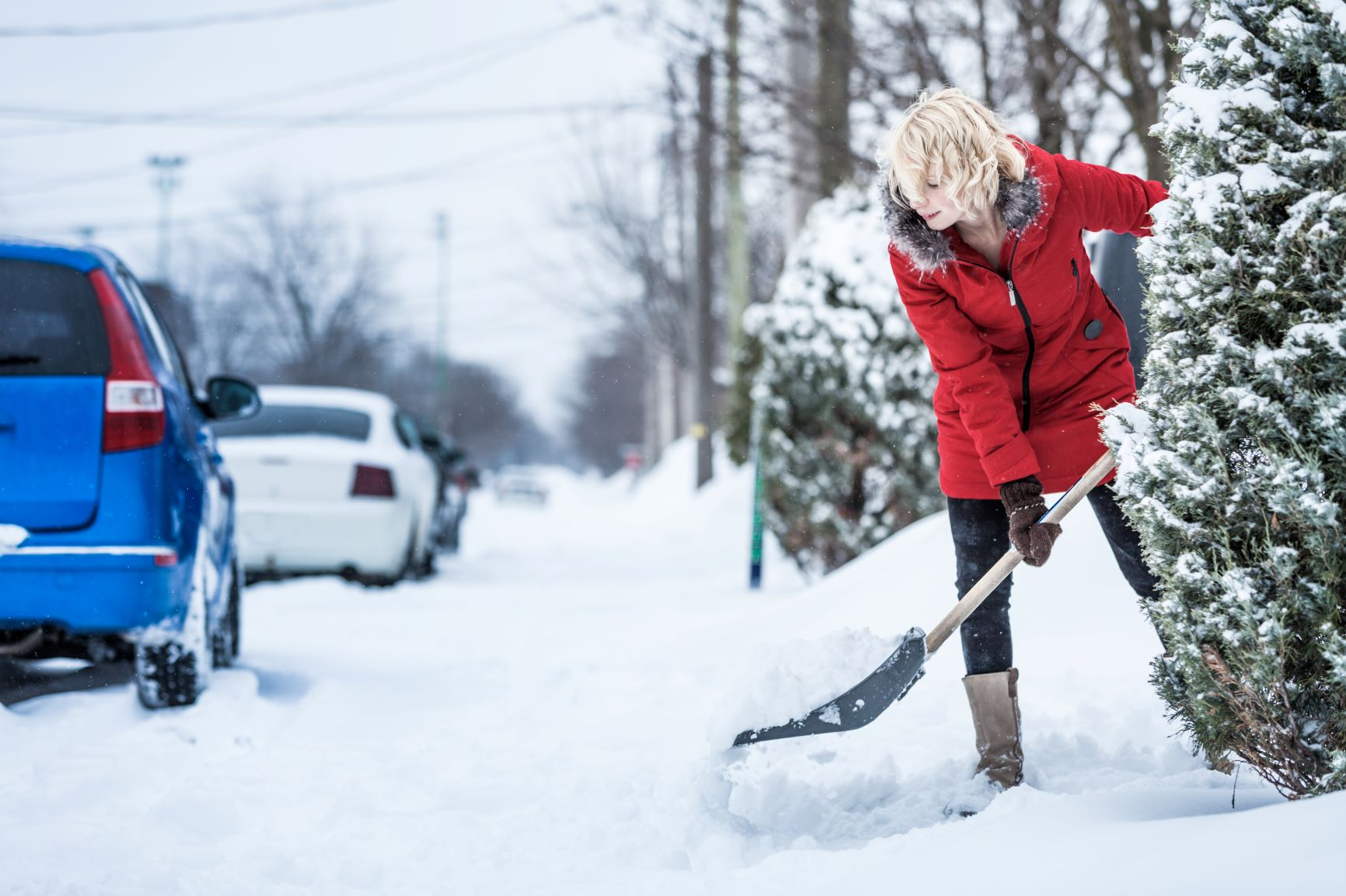 4. Canva - Woman Shoveling her Parking Lot